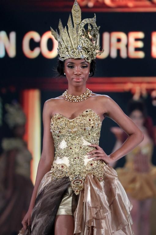 Miss Cameroon Denise Valerie Ayena, walks the catwalk during the fashion show of Miss World contestants at a convention center in Nusa Dua, on Indonesia's resort island of Bali on September 24, 2013