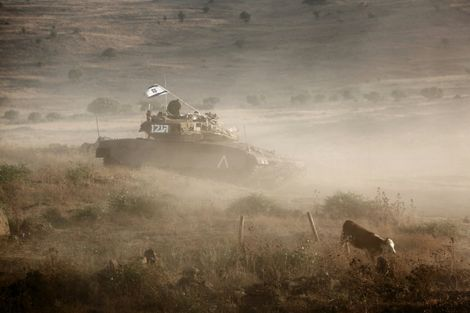 An Israeli tank takes part in a military exercise in the Israeli-annexed Golan Heights near the border with Syria