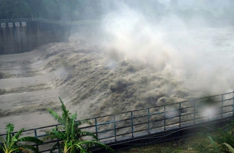 Churning waters in the Jhihtan Dam is seen in Xindian district, New Taipei City, as Typhoon Megi hit eastern Taiwan
