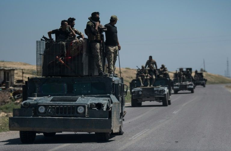 Turkish military convoy moves closer to Syrian Kurds