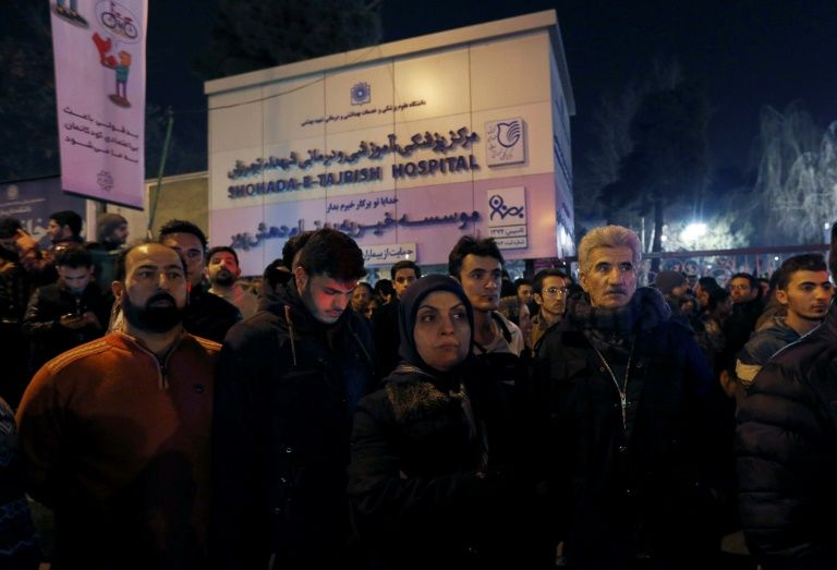 People arrive to mourn after the death of former Iranian president Akbar Hashemi Rafsanjani, at Tajrish Hospital in Tehran, on January 8, 2017.Rafsanjani, died in hospital after suffering a eart attack