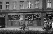 A Jewish-run store vandalised by Nazis and daubed with anti-Semitic graffiti in Germany, on November 10, 1938