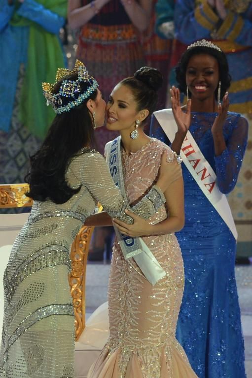New Miss World, Megan Young (C), from the Philippines is congratulated by outgoing Miss World Yu Wenxia (L) after winning the crown during the Miss World 2013 finals in Nusa Dua, in Indonesia's resort island of Bali on September 28, 2013
