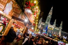 People crowd the Christmas market in front of Vienna's City Hall on November 26, 2015