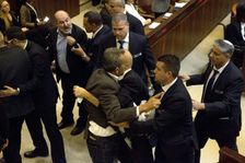 Israeli Arab lawmakers scuffle with security after they held signs to protest a speech by US Vice President Mike Pence in Israel's parliament on January 22, 2018 and are ushered out of the Knesset