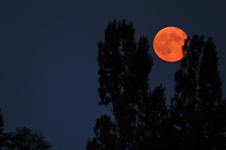 A 'supermoon' is seen from the central French city of Luynes, in September 2014
