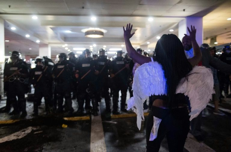 Police in Charlotte, North Carolina were briefly outnumbered during violent protests and forced to retreat to the safety of an upscale hotel lobby