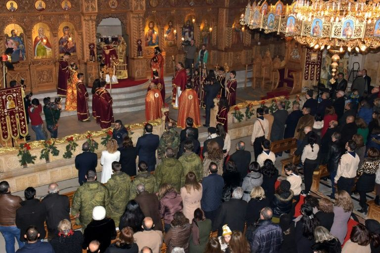 Greek Orthodox Patriarch of Antioch and All East John X Yazigi leads prayers during Christmas mass at the Elias Orthodox Church in Aleppo on December 24, 2016