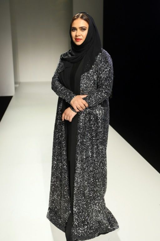 Emirati fashion designer Lamya Abedin poses on the runway following her show at the Arab Fashion Week in Dubai on October 6, 2016