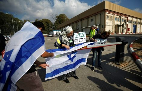 Staff of Israeli pharmaceutical giant Teva protest outside its plant in Kiryat Shmona, in northern Israel, on December 14, 2017 over its plans to axe thousands of jobs