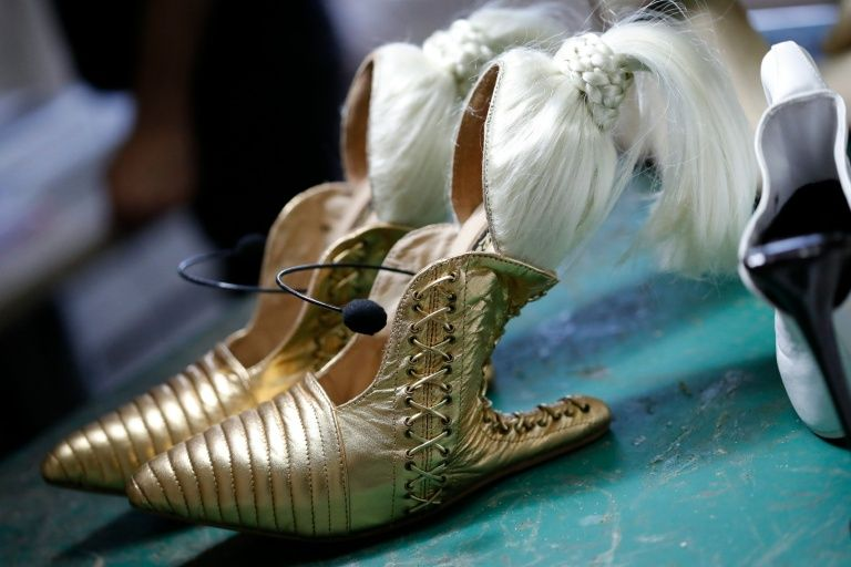 Israeli designer Kobi Levi uses a vintage sewing machine and an old leather press to turn his designs from fantasies into shoes