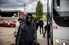 A migrant arrives by bus from the Calais Jungle, on October 24, 2016 at the Montlaville castle in Chardonnay