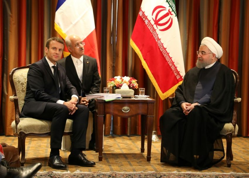France's President Emmanuel Macron (L) meets with Iranian president Hassan Rouhani (R) in New York for the UN General Assembly on September 18, 2017