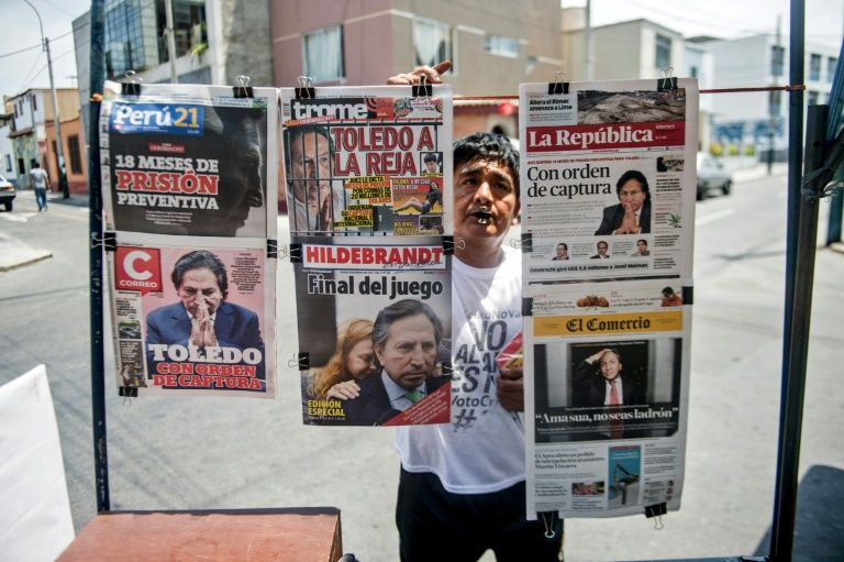 Newspapers with the portrait of former Peruvian President (2001-2006) Alejandro Toledo on their front pages, are displayed for sale in Lima on February 10, 2017
