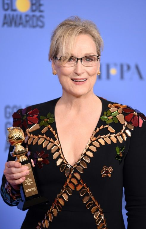 Actress Meryl Streep poses with The Cecil B. DeMille Award in the press room during the 74th Annual Golden Globe Awards, at The Beverly Hilton Hotel in Beverly Hills, California, on January 8, 2017