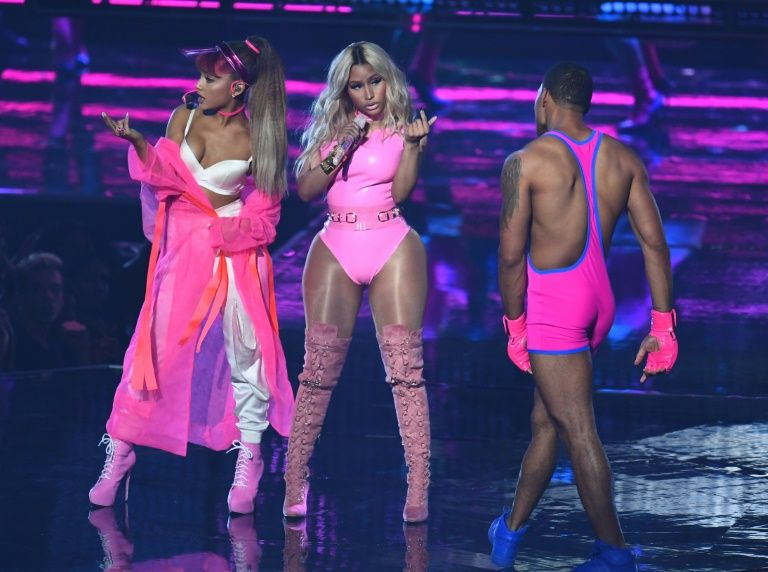 Ariana Grande and Nicki Minaj performed on a stage transformed into a gym