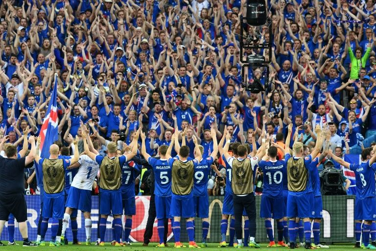 Iceland's players celebrate after the Euro 2016 group F football match between Iceland and Austria in June