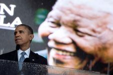 Obama warns of 'strange and uncertain times' in Mandela tribute