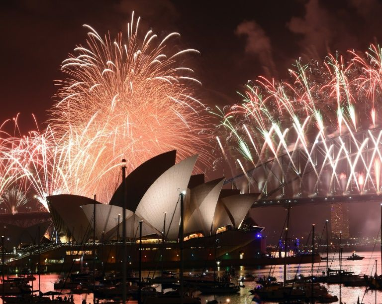 New Year's Eve fireworks illuminate the sky over the iconic Opera House and Harbour Bridge in Sydney on January 1, 2017