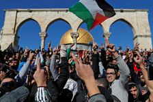 Palestinian Muslim worshippers shout slogans during Friday prayer at the Al-Aqsa mosque compound in Jerusalem's Old City on December 8, 2017