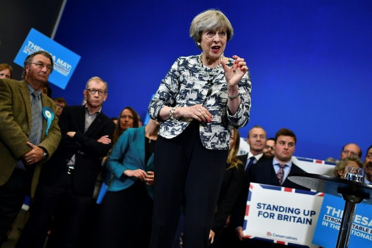 Defiant May vows to lead Britain to Brexit after United Kingdom election blow