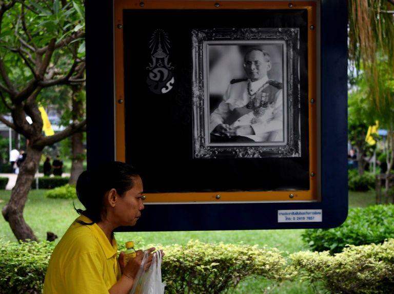 A woman offers prayers as she mourns the death of Thailand's King Bhumibol Adulyadej at Bangkok'S Siriraj Hospital