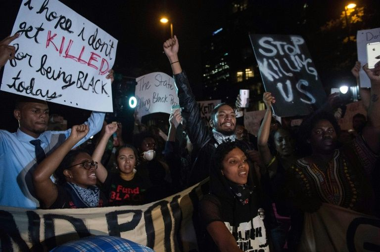 Protesters chant slogans during a march in Charlotte, North Carolina, on the third night of protests following the fatal police shooting of a black man
