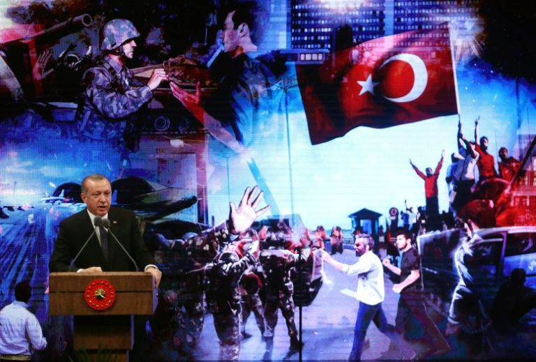 Turkey sacks 7400 civil servants on anniversary of coup