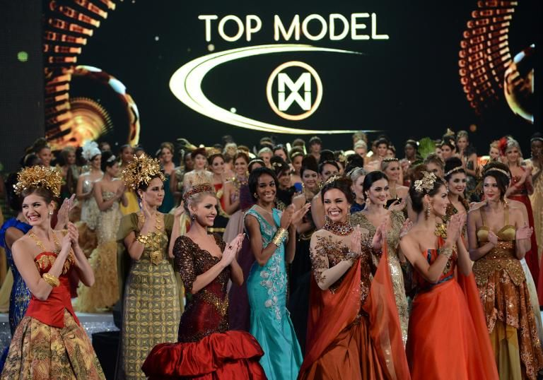 Miss World 2013 contestants clap during a fashion show on the catwalk in Nusa Dua on Indonesia's resort island of Bali on September 24, 2013