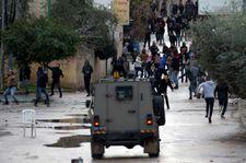 Palestinians return weapons stolen from IDF soldiers ambushed in Jenin