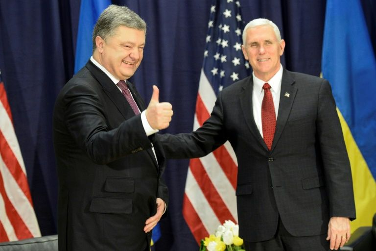"""Ukraine President Petro Poroshenko (left) claims he had a """"very important meeting"""" with US Vice President Mike Pence in Munich, on February 18"""