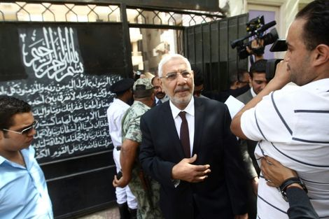 Egyptian moderate Islamist presidential candidate Abdel Moneim Abul Fotouh arrives at a polling station to vote in Cairo on May 23, 2012