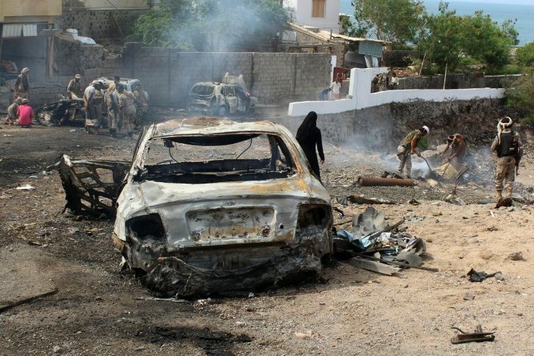 Yemeni loyalist forces and onlookers gather at the scene of a suicide attack targeting the police chief in Aden on April 28, 2016