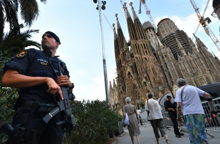 Mourners gathered in Barcelona's Sagrada Familia basilica to remember the 14 people killed in two deadly vehicle attacks claimed by the Islamic State group