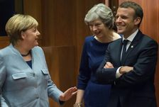 In an apparently symbolic move Theresa May walked into the summit room flanked by both Angela Merkel and Emmanuel Macron