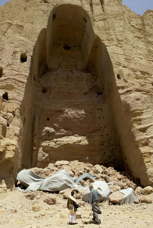 May 18, 2002, visitors walk past the remains of the giant Buddhas of Bamiyan