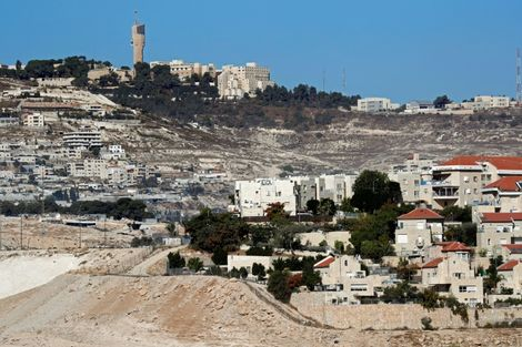 The West Bank Israeli settlement of Maale Adumim (foreground-R), a few kilometers from East Jerusalem (background), would be absorbed into Jerusalem under a bill opponents say paves the way for unilateral annexation of West Bank settlements by Israel