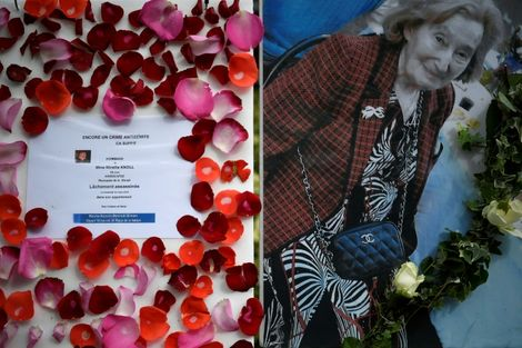 A picture of Mireille Knoll and a message announcing a silent march in her memory outside her apartment building in Paris on Tuesday