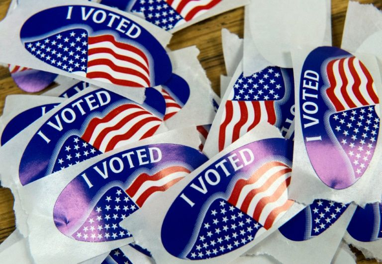 "A stack of ""I voted"" stickers at a polling station in Virginia"