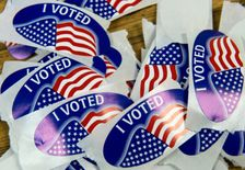 """A stack of """"I voted"""" stickers at a polling station in Virginia"""