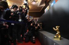 The Golden Bear for Best film trophy, awarded to Iranian dissident director Jafar Panahi in absentia for his film Taxi, is on display after the closing ceremony of the 65th International Film Festival Berlinale on February 14, 2015 in Berlin