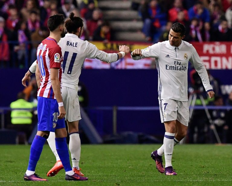 Cristiano Ronaldo (right) celebrates a goal with Gareth Bale during the match against Atletico de Madrid