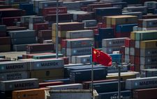 Xi vows to further open China economy as US trade spat simmers
