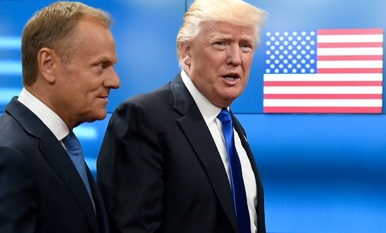 European Council President Donald Tusk welcomes US President Donald Trump at EU headquarters in Brussels on May 25, 2017
