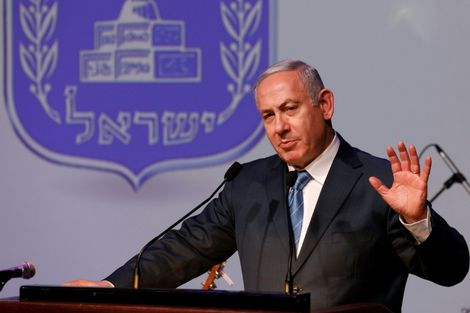 Israeli Prime Minister Benjamin Netanyahu gestures as he speaks during the annual New Year's toast in Jerusalem on December 12, 2018
