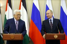Russian President Vladimir Putin (R) and Palestinian leader Mahmud Abbas take part in a videoconference with Bethlehem following a meeting at the Bocharov Ruchei residence in the Black sea resort of Sochi on May 11, 2017