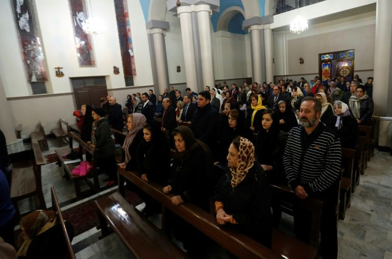 Iranian Christians attend Christmas Eve mass at the St Joseph Armenian Catholic church in Tehran on December 24, 2016, as Christians around the world are celebrating Christmas