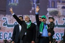 Hamas leader Ismail Haniya (L) and Hamas's leader in the Gaza Strip Yahya Sinwar wave during a rally marking the 30th anniversary of the founding of the Islamist movement, in Gaza City, on December 14, 2017