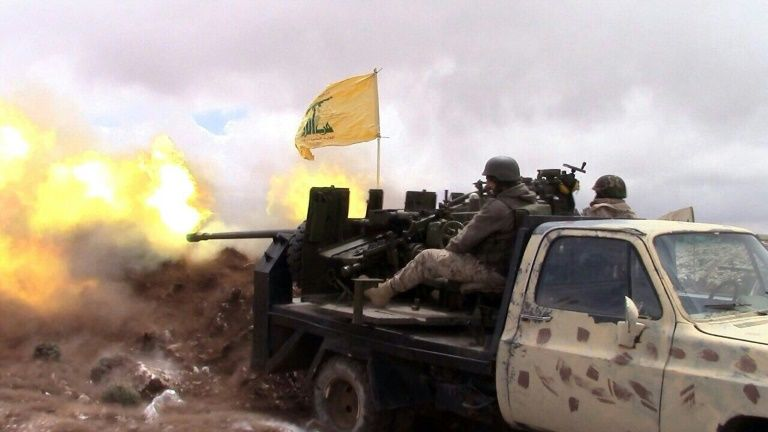 A Hezbollah fighter fires towards Syrian rebel areas on the Syrian side of the Qalamun hills close to the Lebanese border on May 16, 2015