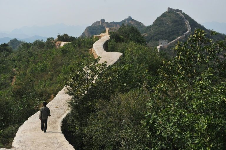 A villager walks on a paved-over section of the Great Wall of China at Suizhong, in the northeast Liaoning province on September 21, 2016